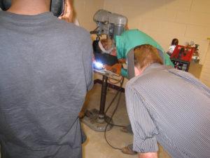 ProCSI 2009 students watch a welder