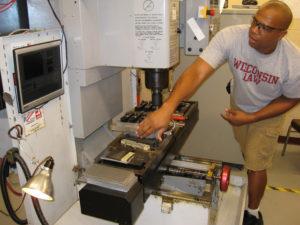 A ProCSI 2009 lab leader shows off a machine