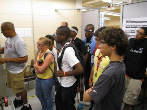ProCSI 2009 members look on during a lab presentation