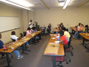 ProCSI 2009 members listen in during a discussion after a pizza party