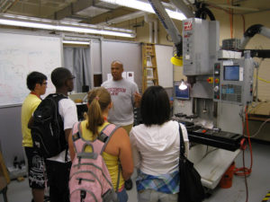 A ProCSI 2009 group watches a lab member