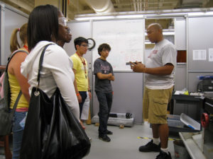 A ProCSI 2009 group listens to a demonstration