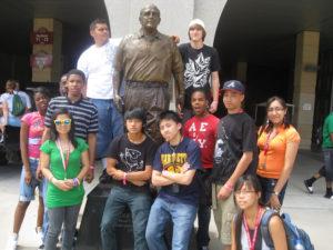 ProCSI 2010 members pose with a statue of Barry Alvarez