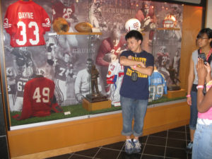 A ProCSI 2010 member poses with a trophy at Camp Randall