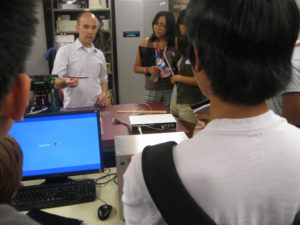 ProCSI 2010 members look on during a lab demonstration