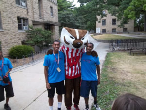 Two ProCSI 2012 member poses with Bucky Badger