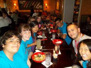 ProCSI 2012 members pose while eating dinner