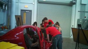 ProCSI 2013 members look at a car in a lab