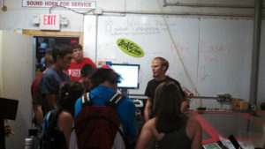 ProCSI 2013 members listen to a lab leader during a tour