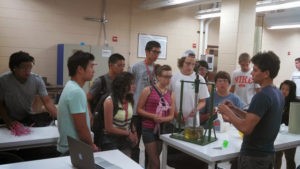 ProCSI 2013 members listen during a lab demonstration