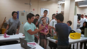 ProCSI 2013 members watch a fellow student help during a demonstration