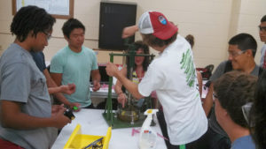 A ProCSI 2013 member helps during a lab demonstration