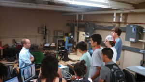 ProCSI 2013 members listen to a lab member during a tour