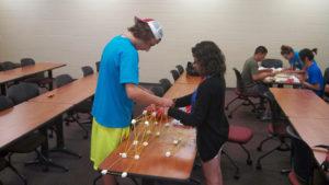 Two ProCSI 2013 members work together to build a sturdy bridge