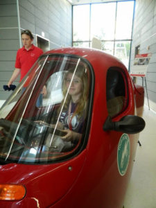 A ProCSI 2014 student sits in a small car