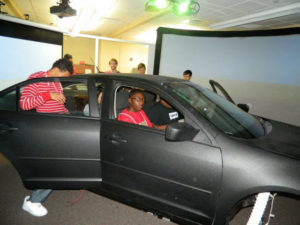 ProCSI 2014 members get in a driving simulator
