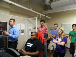 ProCSI 2014 members watch one student on a simulator