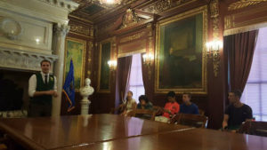 ProCSI 2015 members in a room during a tour of the Wisconsin capitol