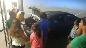 ProCSI 2015 members inspect a driving simulator