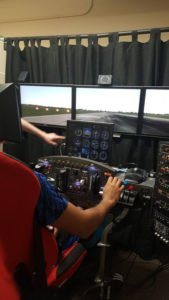 A ProCSI 2015 student tries a flight simulator