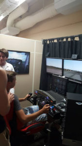 One ProCSI 2015 member tests out a flight simulator