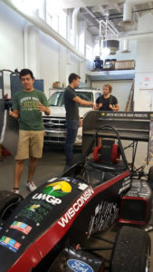 ProCSI 2015 members look at a race car