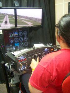 A close-up of a ProCSI 2016 camper tests a flight simulator