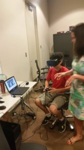 A ProCSI 2016 member uses virtual reality goggles