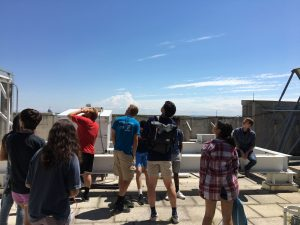 ProCSI 2018 students on the roof of a building during a tour of the space science and engineering center